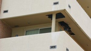 Rotted door jambs and patched holes in balcony ceilings are among the obvious damages. Photo by Jeff Prince.