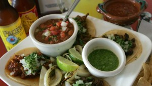 Papaya's street taco sampler is big on flavor and low on cost. Photo by Lee Chastain.