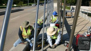 A work crew prepares Fort Worth's coolest bridge for its close-up. Photo by Jeff Prince.