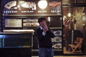 "Jeong Jae-yeong looks for a good sushi place in ""Right Now, Wrong Then."""