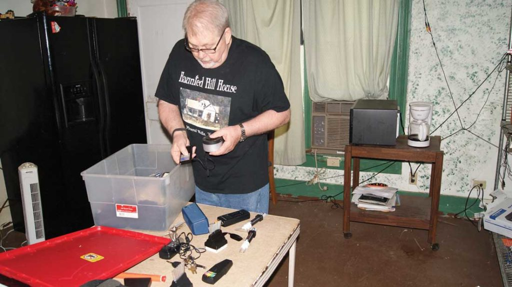 Kirchhoff uses several devices to communicate with the spirits of Haunted Hill House. Photo by Patrick Holden, Jr.