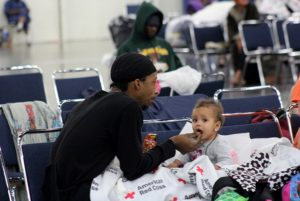 A lot of families were displaced into the George R. Brown Convention Center. Photo by Doogie Roux.