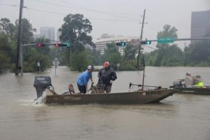 A water rescue is conducted at North Post Oak and Woodway on the outskirts of downtown Houston. Photo by Doogie Roux.