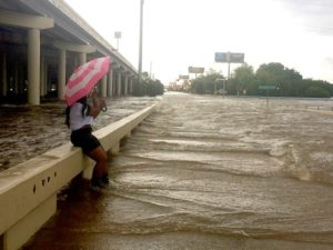 An umbrella didn't furnish a lot of protection Sunday morning at Yale and Interstate 10. Photo by Meagan Flynn.