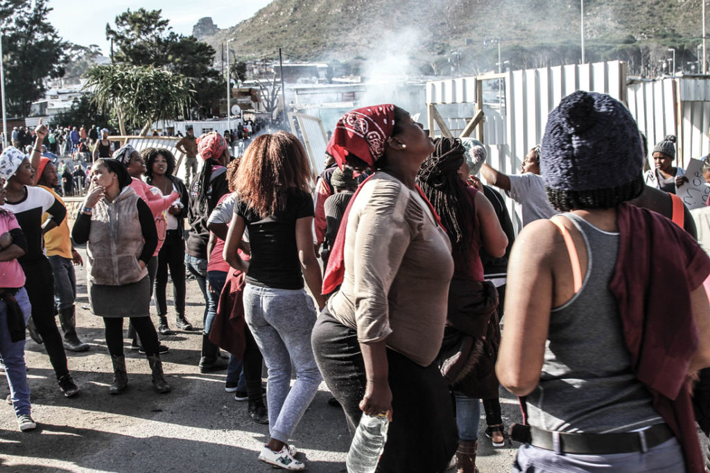 Protesters sing in the streets of Imizamo Yethu, Hout Bay, on July 1, 2017. Photo by Peter Michaels.