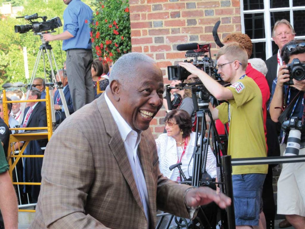 Hank Aaron, who hit 755 home runs, arrives at the Hall of Fame Museum to welcome its newest members.