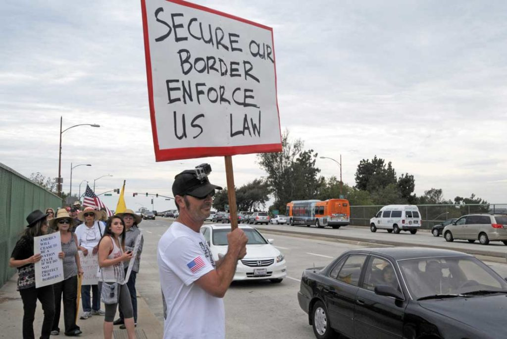 A supporter in Burbank, Calif., has a message for illegal immigrants. Photo by DnHolm.
