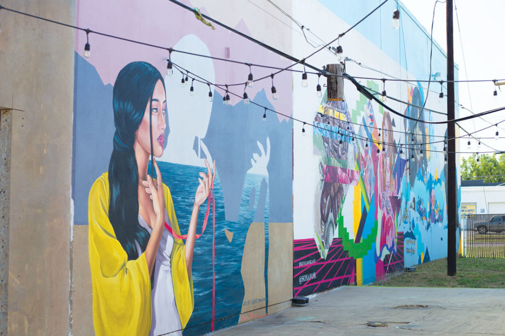 "Multiple artists painted a mural of varying shapes, sizes, and themes as part of ""Inspiration Alley."" Photo by Cheyenne Hammons."
