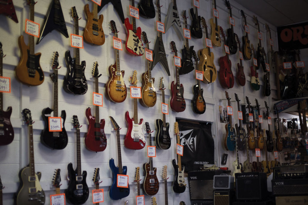 "Our critic is still amazed by Zoo Music, the ""gold standard for local instrument shops."" Photo by Cheyenne Hammons."