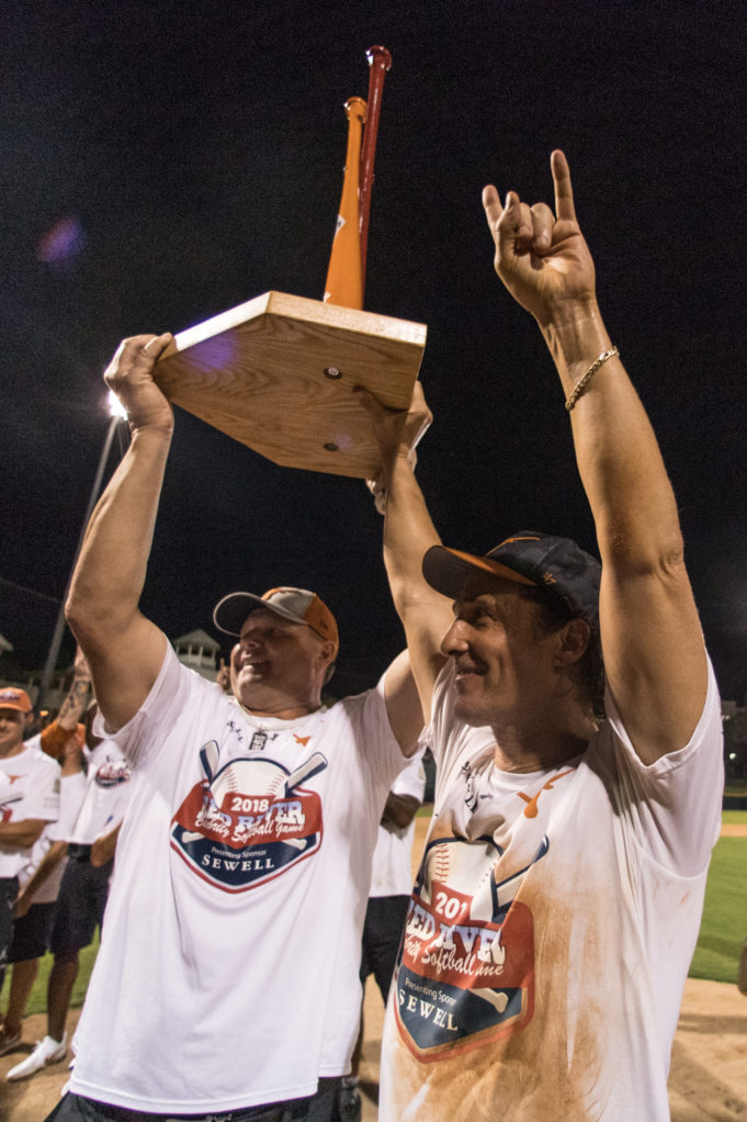 Roger Clemens and Matthew McConaughey hoist the Red River softball trophy